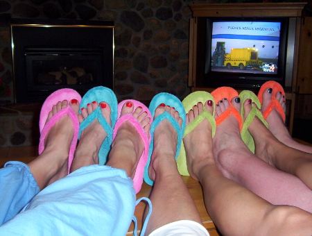 Three of my friends and I celebrated pedicures at a cabin retreat in 2004.  That's when I first got the turquoise slippers--and I'm still wearing them nine years later.  I know--ewww! And, I wear them while riding bike.  But not on purpose.