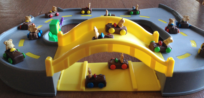 The one with the green tires approaching the bridge is speeding.